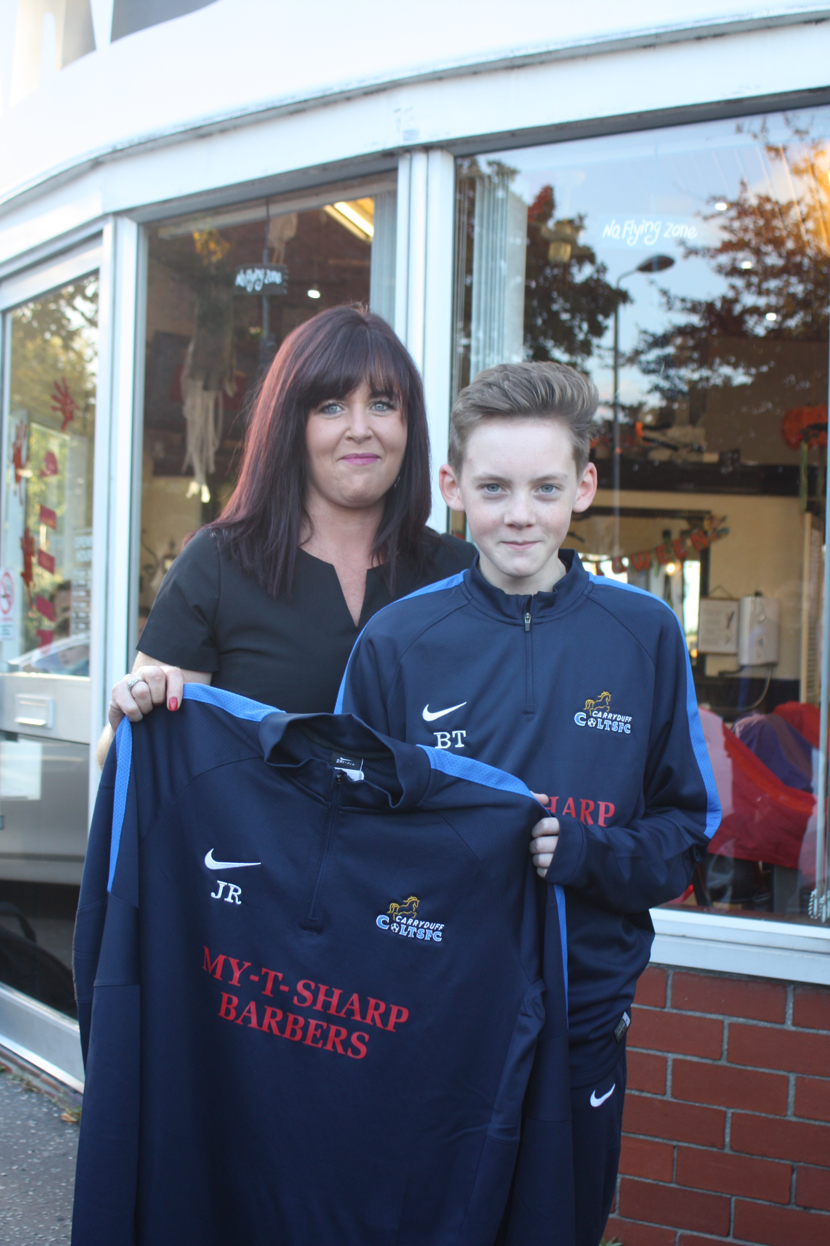 carryduff colts u sponsors carryduff colts keith mcmanus and brian maguire of mcguire farry accountants in carryduff hand over a new set of jerseys to the carryduff colts u15 squad